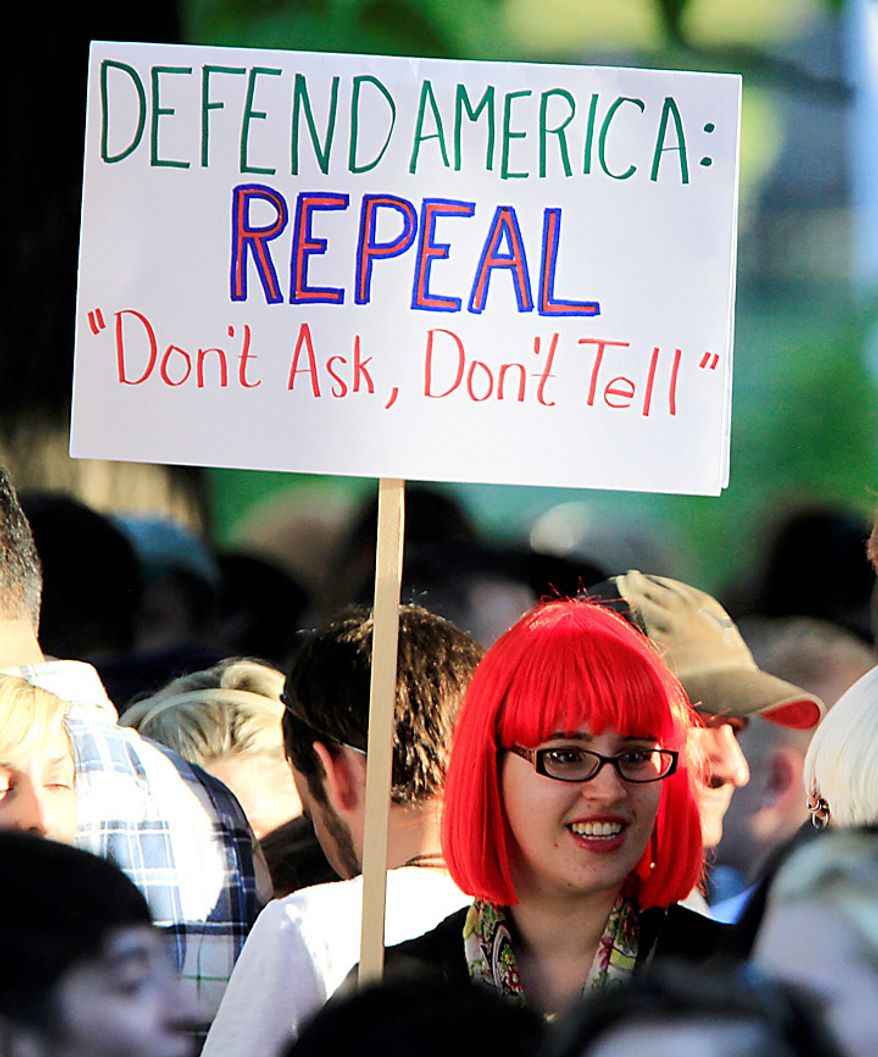 "A member of the crowd shows her support as recording artist Lady Gaga speaks at a rally in support of repealing the military's ""don't ask, don't tell"" policy for gay service members, in Portland, Maine, on Monday, Sept. 20, 2010.  (AP Photo/Pat Wellenbach)"