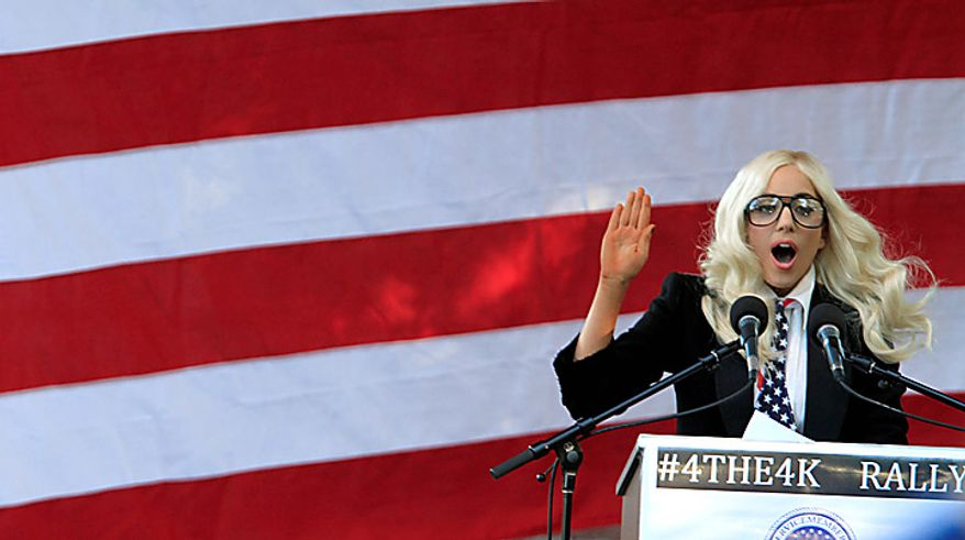 "Recording artist Lady Gaga speaks at a rally in support of repealing the so-called ""don't ask, don't tell"" law, in Portland, Maine, on Monday, September 20, 2010. The current law bars gays and lesbians from openly serving in the military, and a spokesperson said that Lady Gaga wants Maine's Republican senators to cast votes this week to help repeal the military's ""don't ask, don't tell"" policy on gays in the military. (AP Photo/Pat Wellenbach)"