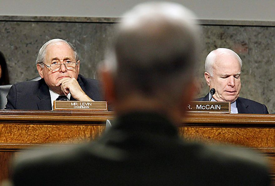 Senate Armed Services Committee Chairman Sen. Carl Levin, D-Mich., left, and the committee's ranking Republican Sen. John McCain, R-Ariz., right, listen as US Marines Gen. James F. Amos, back to camera, testifies on Capitol Hill in Washington, Tuesday, Sept. 21, 2010, before the committee's hearing on Amos' reappointment to the grade of general and the be Commandant of the Marine Corps.  (AP Photo/Alex Brandon)