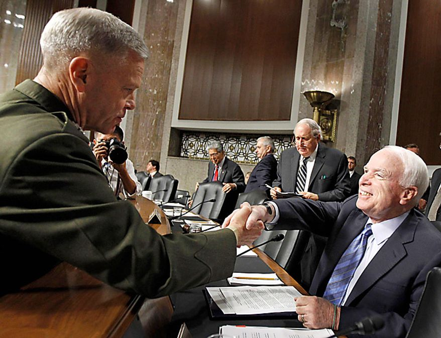 US Marines Gen. James F. Amos , left, shakes hands with the Senate Armed Services Committee ranking Republican Sen. John McCain, R-Ariz., on Capitol Hill in Washington, Tuesday, Sept. 21, 2010, prior to testifying before the committee's hearing on his nomination for reappointment to the grade of general and the be Commandant of the Marine Corps. Committee members, from left are, Sen. Daniel Akaka, D-Hawaii, Sen. Jack Reed, D-R.I., committee Chairman Sen. Carl Levin, D-Mich., and McCain. (AP Photo/Alex Brandon)