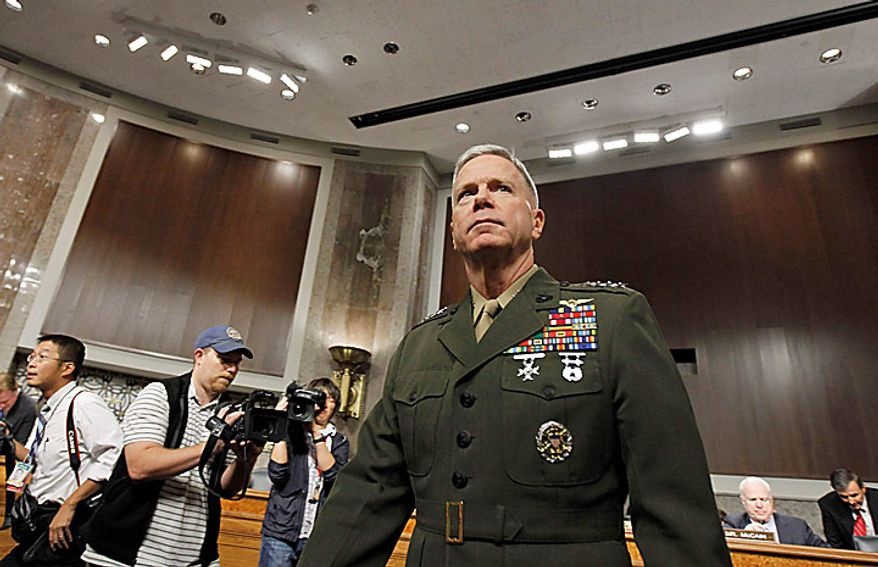 Marine Gen. James Amos arrives on Capitol Hill in Washington on Tuesday, Sept. 21, 2010, to testify before the Senate Armed Services Committee on his nomination for reappointment to the grade of general and as commandant of the Marine Corps. (AP Photo/Alex Brandon)