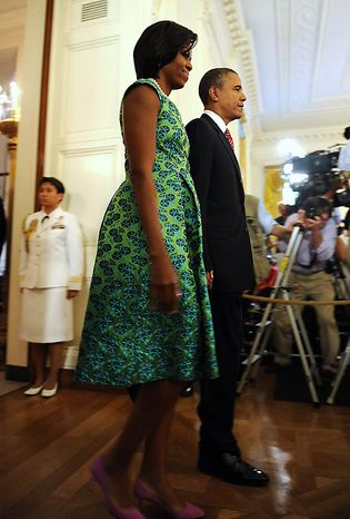 First Lady Michelle Obama and U.S. President Barack Obama arrive to award Chief Master Sergeant Richard L. Etchberger, U.S. Air Force, the Medal of Honor for conspicuous gallantry in the East Room of the White House in Washington on September 21, 2010. Etchberger was killed in Laos in 1968 helping to save wounded men. UPI/Roger L. Wollenberg