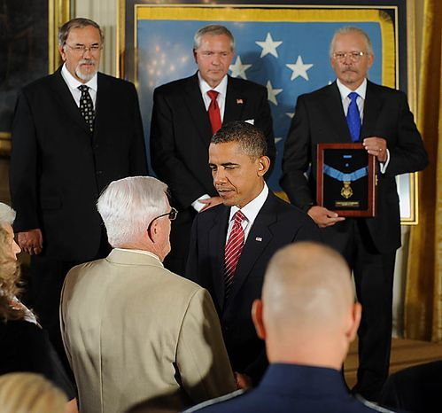 U.S. President Barack Obama greets brother Bob Etchberger as Richard's sons Steven Wilson and Cory and Richard Etchberger look on after Obama awarded Chief Master Sergeant Richard L. Etchberger, U.S. Air Force, the Medal of Honor for conspicuous gallantry in the East Room of the White House in Washington on September 21, 2010. Etchberger was killed in Laos in 1968 helping to save wounded men. UPI/Roger L. Wollenberg