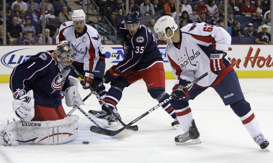 ASSOCIATED PRESS Columbus Blue Jackets' Steve Mason, left, makes a save as teammate Jan Hejda (35), of the Czech Republic, Washington Capitals' Andrew Gordon, right, and Jason Chimera wait for a rebound during the first period of an NHL preseason hockey game Wednesday, Sept. 22, 2010, in Columbus, Ohio.