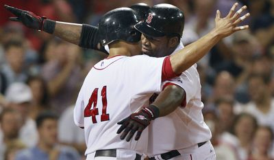 ASSOCIATED PRESS Boston Red Sox designated hitter David Ortiz, right, celebrates his three-run home run with Victor Martinez (41), off Baltimore Orioles pitcher Kevin Millwood in the fourth inning of a baseball game at Fenway Park in Boston, Wednesday, Sept. 22, 2010.