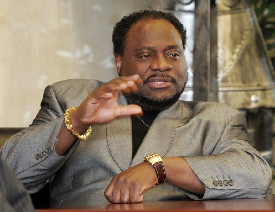 ** FILE * Bishop Eddie Long of the New Birth Missionary Baptist Church in Lithonia, Ga., gestures during an interview in 2007. On Tuesday, Sept. 21, 2010, two men filed a lawsuit accusing Bishop Long of exploiting his role as pastor of the Atlanta-area megachurch to coerce them into sexual relationships when they were members of his congregation. (AP Photo/Gene Blythe, File)