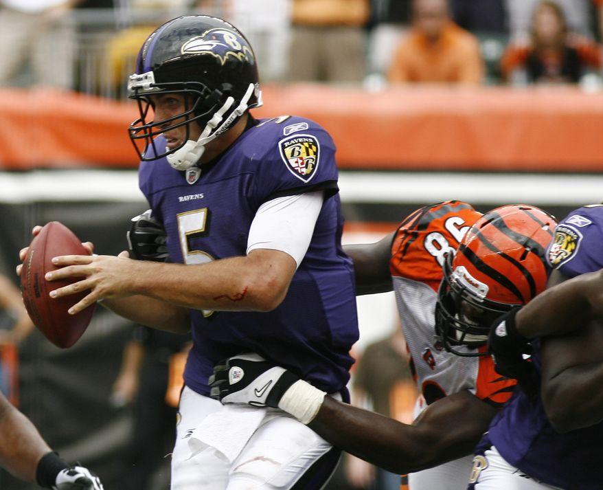 ASSOCIATED PRESS Baltimore Ravens quarterback Joe Flacco (5) is pressured by Cincinnati Bengals defensive end Antwan Odom (98) in the first half of an NFL football game Sunday, Sept. 19, 2010, in Cincinnati. Flacco threw four interceptions as Cincinnati won 15-10.