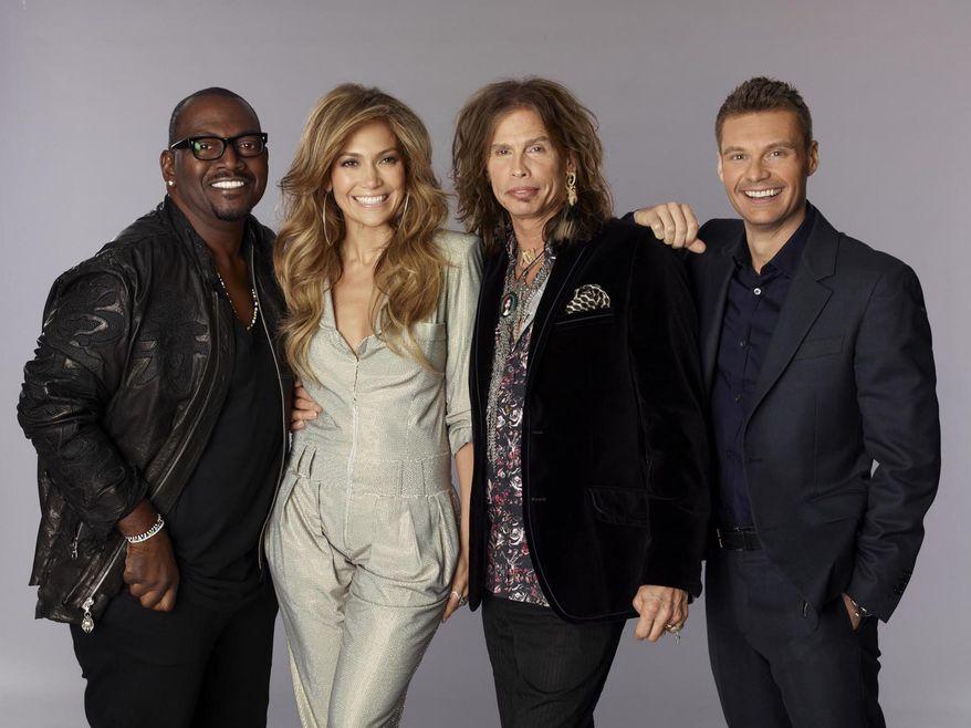 Judges for season ten of American Idol, from left, Randy Jackson, Jennifer Lopez, Steven Tyler and Ryan Seacrest, in a publicity image released by Fox. (AP Photo/Fox, Michael Becker)