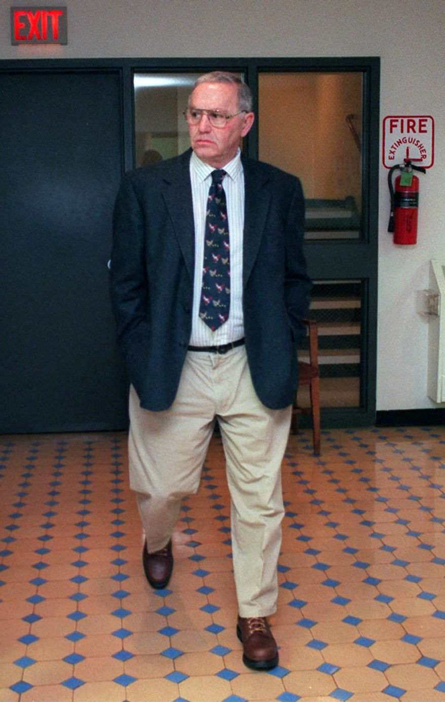 "In this 1997 file photo Austin ""Jack"" DeCoster, owner of an Iowa egg farm, walks to the courtroom in the Wright County Court house to testify in defense of his family's hog confinement facilities. (AP Photo/Kevin Wolf, File)"