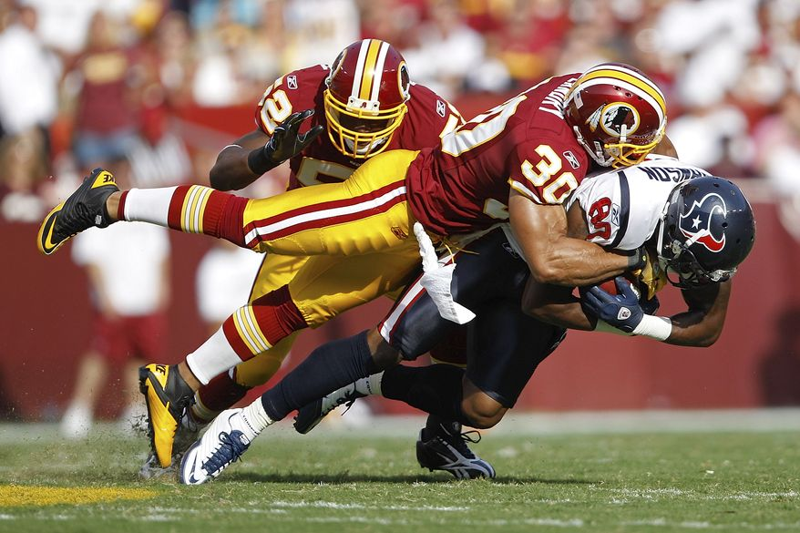 ASSOCIATED PRESS Houston Texans wide receiver Andre Johnson is stopped by Washington Redskins safety LaRon Landry (30) and linebacker Rocky McIntosh during the first half of an NFL football game in Landover, Md., on Sunday, Sept.. 19, 2010.