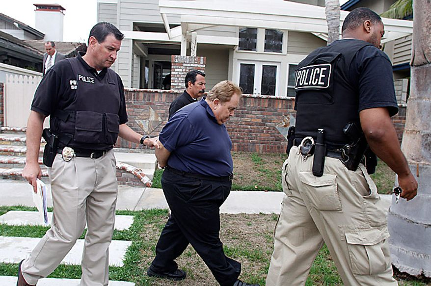 Former Bell City Manager Robert Rizzo, whose high salary sparked the outrage that led to the investigations of the city, is arrested by police at his Huntington Beach, Calif. home on Tuesday, Sept. 21, 2010 (AP Photo/Los Angeles Times, Robert Lachman)
