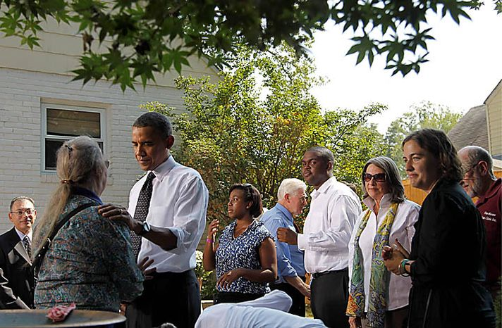 President Barack Obama meets with guest in the backyard of a private residence in Falls Church, Va., Wednesday, Sept. 22, 2010, to discuss the Patient's Bill of Rights and health care reform. (AP Photo/Pablo Martinez Monsivais)