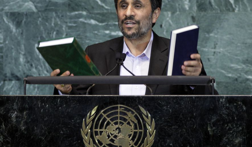 ASSOCIATED PRESS Mahmoud Ahmadinejad, President of Iran, holds up a copies of the Quran, left, and Bible, right, as he addresses the 65th session of the United Nations General Assembly at U.N. headquarters Thursday, Sept. 23, 2010.