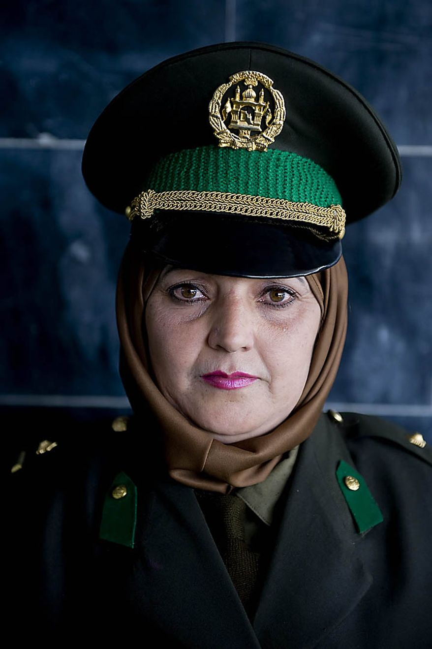 A newly trained officer of the Afghan National Army attends her graduation ceremony at the National Army's training center in Kabul, Afghanistan, on September 23, 2010. UPI/Hossein Fatemi