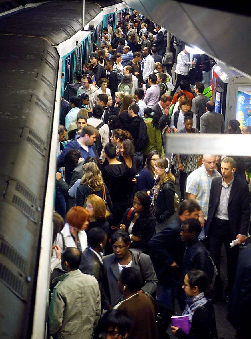 Passengers crowd a subway train Thursday, Sept. 23 2010, in Paris. Protesters are counting on people power to pressure the government to back down on its plan to up the retirement age from 60 to 62, with a second round of September strikes expected to hobble public transport, air traffic and schools across France. (AP Photo/Jacques Brinon)