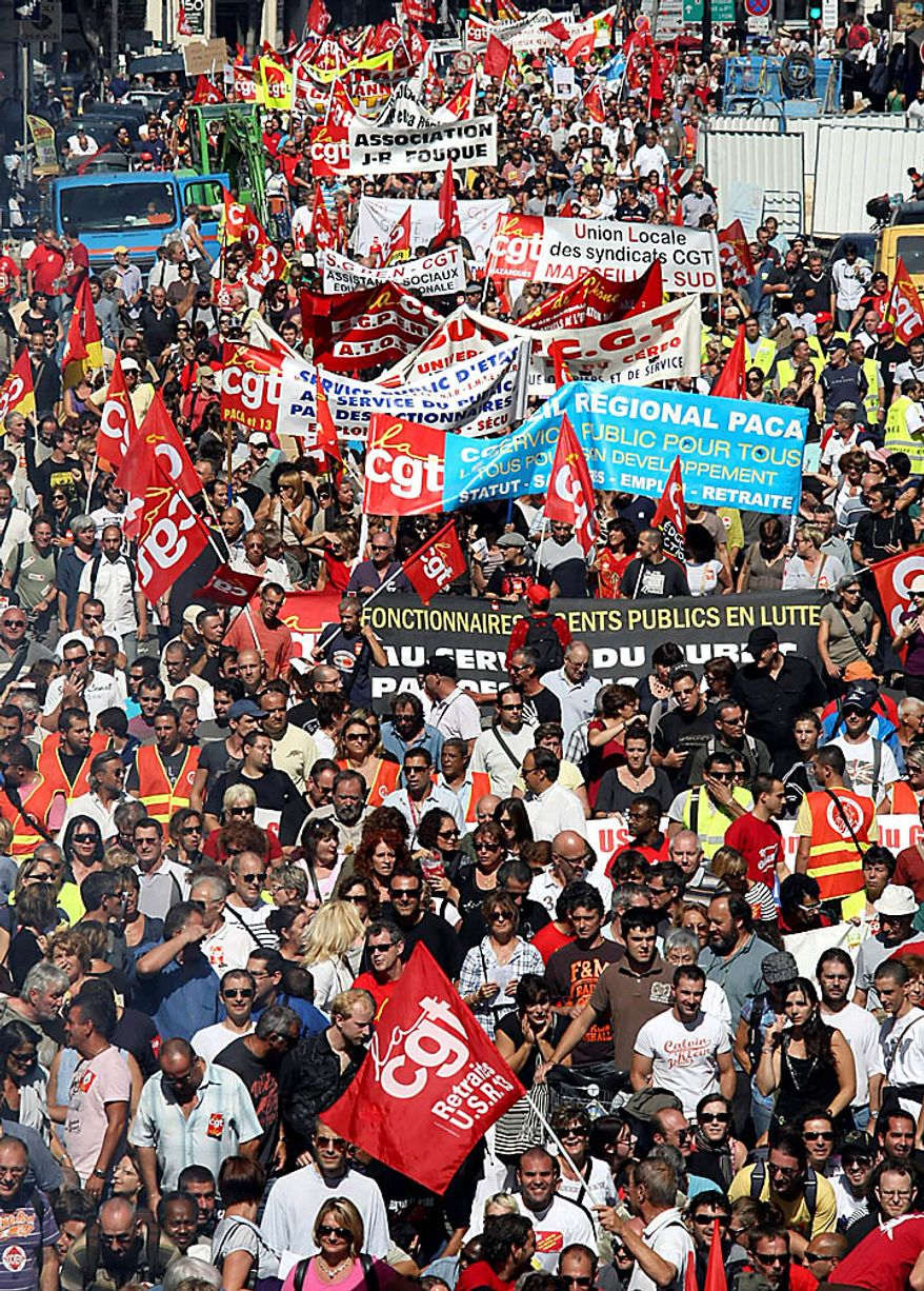 People march during a protest, in Marseille, southern France, Thursday Sept. 23, 2010. French commuters squeezed onto limited trains or fought for rare parking spots Thursday as a second round of strikes against President Nicolas Sarkozy's plan to raise the retirement age to 62 hobbled trains, planes and schools across the country. (AP Photo/Claude Paris)