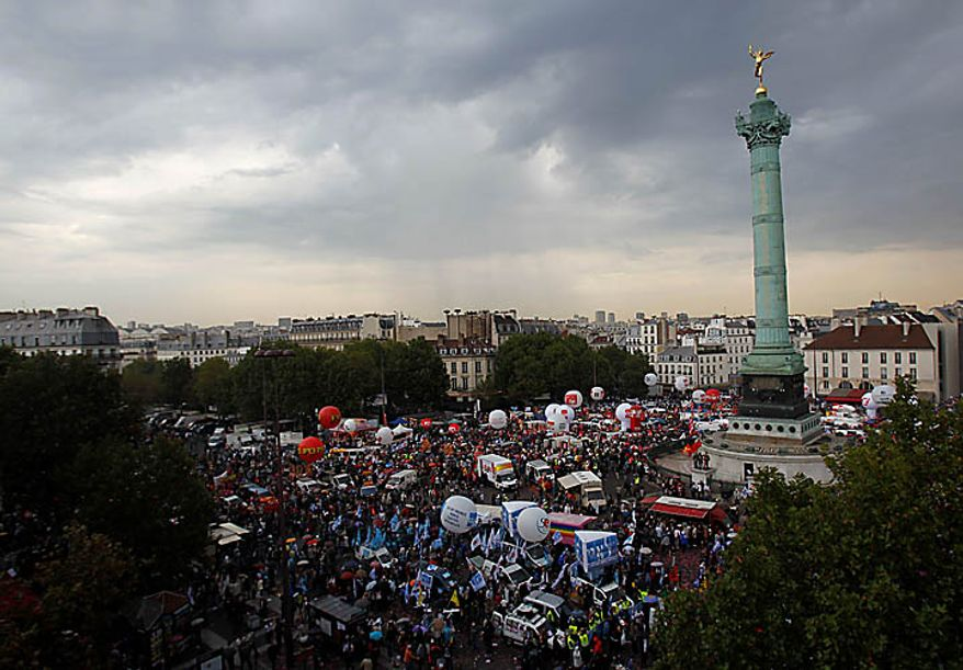 Protesters gather at the Place de la Bastille in Paris on Thursday, Sept. 23, 2010, at the start of a demonstration against French President Nicolas Sarkozy's plan to raise the retirement age to 62. (AP Photo/Christophe Ena)