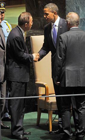 U.S. President Barack Obama, center, shakes hands with United Nations Secretary-General Ban Ki-moon after addressing the United Nations General Assembly at United Nations headquarters on Thursday, Sept. 23, 2010. Looking on at right is General Assembly President Joseph Deiss. (AP Photo/Henny Ray Abrams)