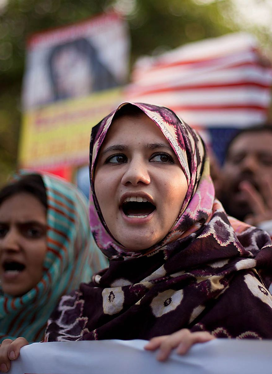 Pakistani protesters rally on Thursday, Sept. 23, 2010, in Islamabad, Pakistan, to condemn the imminent sentencing of Aafia Siddiqui by a federal judge in New York. (AP Photo/B.K. Bangash)