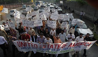 Protesters rally on Thursday, Sept. 23, 2010, in Karachi, Pakistan, to condemn the sentencing of U.S.-trained Pakistani scientist Aafia Siddiqui. (AP Photo/Shakil Adil)