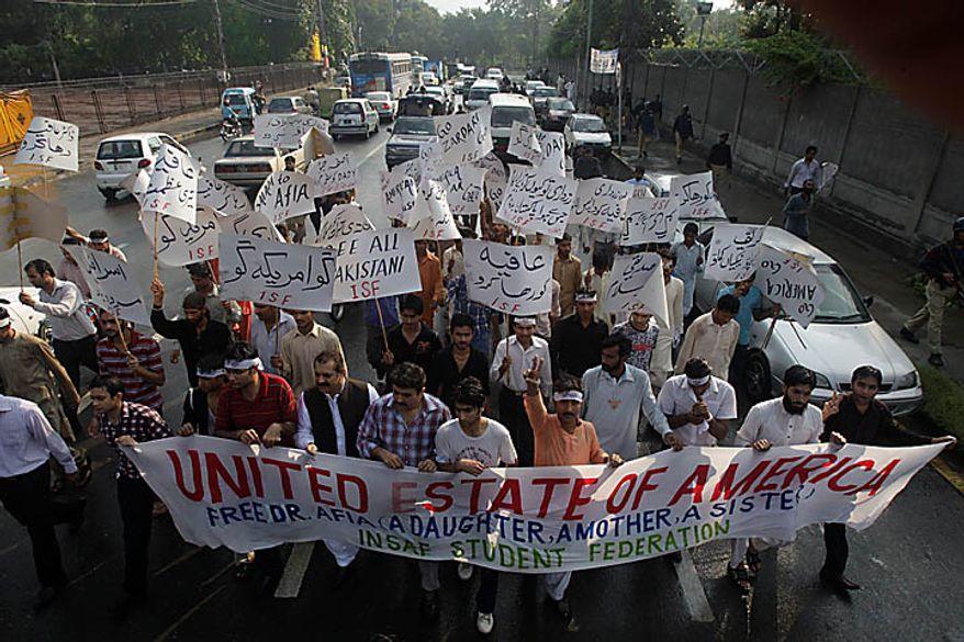 Protesters rally on Thursday, Sept. 23, 2010, in Karachi, Pakistan, to condemn the sentencing of U.S.-trained Pakistani scientist Aafia Siddiqui. (AP Photo/Shakil Adil)