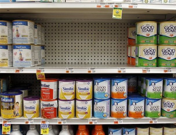 Containers of recalled Similac products are removed from a shelf at a Walgreen's store, Thursday, Sept. 23, 2010, in Guilderland, N.Y. Drugmaker Abbott Laboratories said it is recalling millions of containers of its Similac infant formula that may be contaminated with insect parts. The voluntary action affects up to 5 million Similac-brand powder formulas sold in the U.S., Puerto Rico, Guam and some Caribbean countries. (AP Photo/Mike Groll)