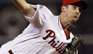Philadelphia Phillies' Cole Hamels pitches in the first inning of a baseball game against the Atlanta Braves, Monday, Sept. 20, 2010, in Philadelphia. (AP Photo/Matt Slocum)