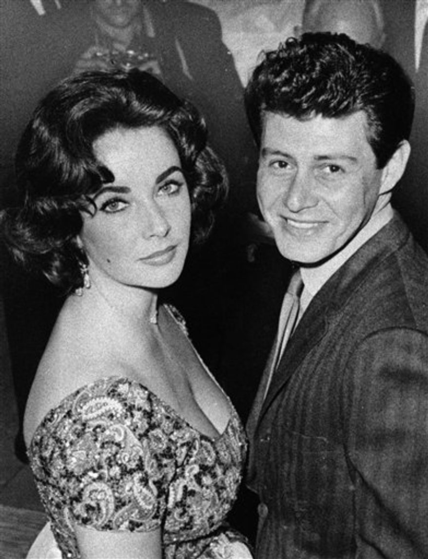 FILE - In this Sept. 26, 1955  file photo, actress Debbie Reynolds and singer Eddie Fisher smile in a pose following their brief marriage ceremony by a county judge at Grossinger, N.Y.  Fisher, whose huge fame as a pop singer was overshadowed by scandals ending his marriages to Debbie Reynolds and Elizabeth Taylor, died Wednesday night Sept. 22, 2010 of complications from hip surgery at a hospital in Berkeley. He was 82. (AP Photo/Marty Lederhandler, File)