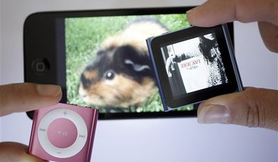 Shown are new Apple iPods from left, the Shuffle, Touch and Nano in San Francisco, Wednesday, Sept. 22, 2010.  (AP Photo/Eric Risberg)