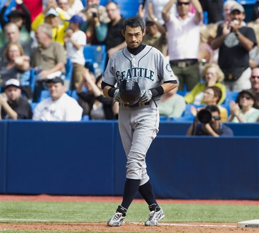 Seattle Mariners Ichiro Suzuki tips his helmet to cheering fans after hitting his 200th hit of the season during fifth inning of a baseball against the Toronto Blue Jays in Toronto, Thursday Sept. 23, 2010. Suzuki became the first player with 10 consecutive 200-hit seasons in big-league history Thursday with a solid single in the fifth inning against the Blue Jays. (AP Photo/The Canadian Press, Frank Gunn)