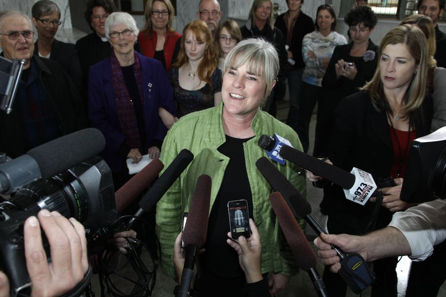 Margaret Witt talks to reporters at the federal courthouse in Tacoma, Wash., Friday, Sept. 24, 2010. A federal judge ruled Friday that Witt, a flight nurse discharged from the Air Force for being gay, should be given her job back as soon as possible. (AP Photo/Ted S. Warren)