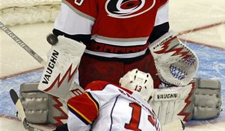 Carolina Hurricanes Riley Nash (23) collides with Florida Panthers Joe Callahan (48) during first period of an NHL preseason hockey game in Raleigh, N.C., Tuesday, Sept. 21, 2010. (AP Photo/Karl B DeBlaker)