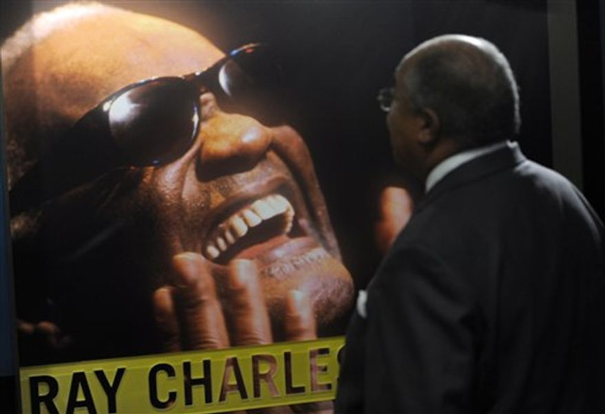 In this Sept. 23, 2010 photo, Sam Moore, left, and Norman Lear pose together at the official opening of The Ray Charles Memorial Library in Los Angeles. The library is located on the ground floor of the Los Angeles building Charles designed for his offices and recording studio. (AP Photo/Chris Pizzello)