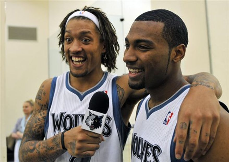 Minnesota Timberwolves' Michael Beasley, left, plays interviewer with teammate Lazar Hayward during NBA basketball media day Friday, Sept. 24, 2010 in Minneapolis. (AP Photo/Jim Mone)