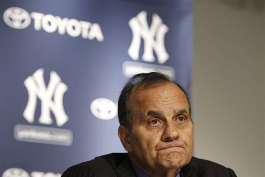 Los Angeles Dodgers manager Joe Torre listens to reporters' questions during a news conference at Yankee Stadium in New York, Monday, Sept. 20, 2010. Torre is at Yankee Stadium for the dedication of a monument to the late Yankees principal owner George Steinbrenner. (AP Photo/Kathy Willens)