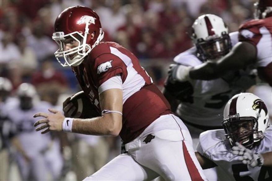 FILE - This Sept. 11, 2010, file photo shows Arkansas quarterback Ryan Mallett carrying the ball during the fourth quarter of an NCAA college football game against Louisiana-Monroe,  in Little Rock, Ark.  No. 1 Alabama's rebuilt defense has looked pretty formidable so far, but the biggest tests for both the players and coaches come in the next three weeks. The Crimson Tide faces Ryan Mallett and Arkansas, then Urban Meyer's Florida Gators and Steve Spurrier's South Carolina Gamecocks. (AP Photo/Danny Johnston, File)