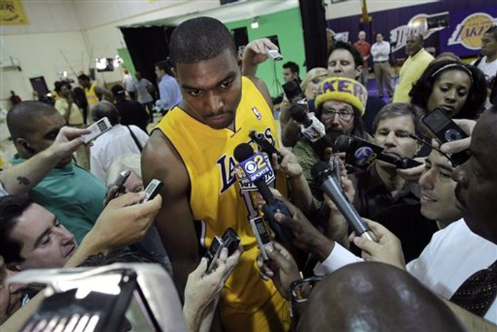 Los Angeles Lakers' Pao Gasol, left, of Spain, Kobe Bryant, center, and Derek Fisher pose for photos during NBA basketball media day at Toyota Sports Center in El Segundo, Calif., Saturday, Sept. 25, 2010. (AP Photo/Jae C. Hong)