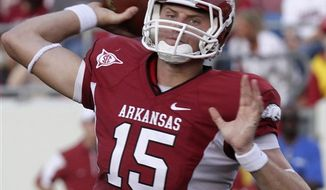 FILE - This Sept. 11, 2010, file photo shows Arkansas quarterback Ryan Mallett passing during the first quarter of an NCAA college football game,  in Little Rock, Ark. Greg McElroy owns a national title at Alabama, Stephen Garcia has South Carolina off to its best start in three years and Ryan Mallett of Arkansas may be the country's best passer. For the Southeastern Conference, known for punishing defenses and ground games, the league has a group of quarterbacks getting things done through the air. (AP Photo/Danny Johnston, File)