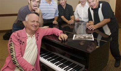 In this Sept. 24, 2010 photo, the Doo-Wop group Sha Na Na rehearses for their special performance to mark the 75th anniversary of Hofstra University in Melville, N.Y.,  From left are Screamin' Scott Simon; Jocko Marcellino; Donny York; Robert Leonard; David Garrett and Elliot Cahn. (AP Photo/Kathleen Malone-Van Dyke)