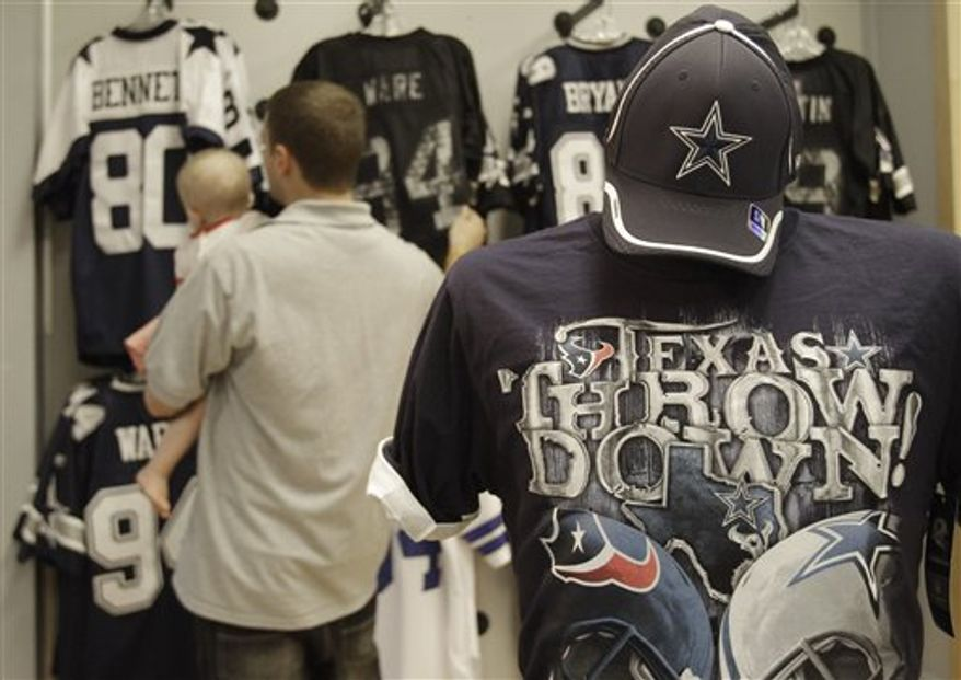 Cowboys fans shop at the Official Dallas Cowboys Pro Shop,  Wednesday, Sept. 22, 2010,  in Katy, Texas,  just outside of Houston. The Cowboys reign in the lone star state with the Houston Texans only an after thought outside of the Houston area. The Cowboys football game against the Texans on Sunday, Sept. 26 in Houston is touted on the tee shirt in the foreground. (AP Photo/Pat Sullivan)