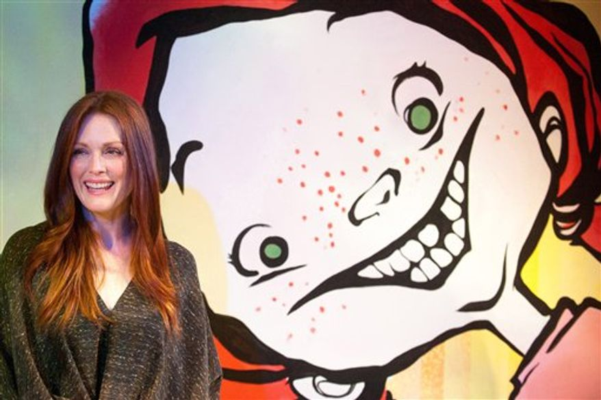 """Actress Julianne Moore, author of the children's book """"Freckleface Strawberry"""", attends a press event for the new off Broadway show """"Freckleface Strawberry The Musical"""" in New York, Thursday, Sept. 23, 2010. (AP Photo/Charles Sykes)"""