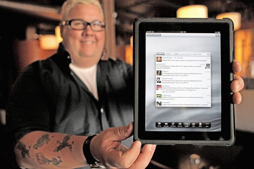 Chef Graham Elliot uses his Twitter account at his restaurant in Chicago, but also tweets about current events and fantasy football picks. He even uses Twitter to let his followers make decisions about the music the restaurant plays. (Associated Press)
