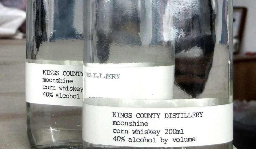 Bottles labeled for moonshine at Kings County Distillery in the Brooklyn Borough of New York describe the product as 40 percent alcohol by volume. Corn is used to make these spirits, but American bootleggers during Prohibition used improper ingredients including wood to make their often toxic whiskey. (Associated Press)