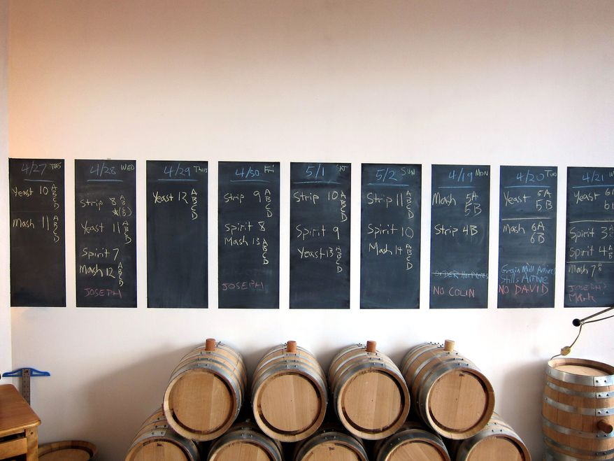 """Barrels at Kings County Distillery in the Brooklyn Borough of New York are used to hold the company's product, though not for very long. King's, which is licensed, sells """"white whiskey"""" in medicine-style bottles labeled simply moonshine. The legal but unaged drink is not as potent as the bootleg whiskey of American folklore. (Associated Press)"""