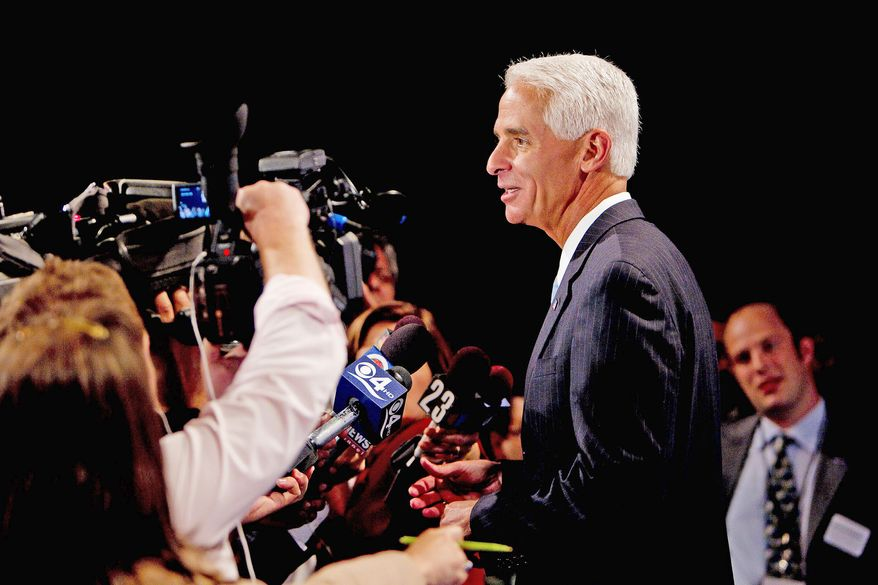 Florida Gov. Charlie Crist, a Republican turned independent, talks to reporters in Miami on Friday after the first debate between the candidates running for an open U.S. Senate seat.