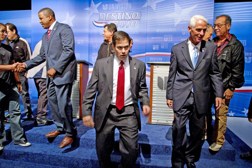 Associated Press SENATE HOPEFULS: Republican Marco Rubio (left) has a big lead over independent rival Charlie Crist in Florida.