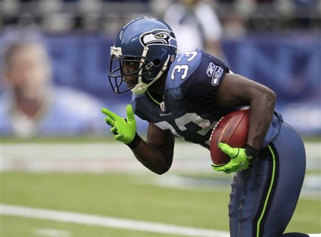 Seattle Seahawks' Leon Washington begins his 99-yard kickoff return for a touchdown against the San Diego Chargers in the second half of an NFL football game, Sunday, Sept. 26, 2010, in Seattle. The Seahawks beat the Chargers 27-20. (AP Photo/Elaine Thompson)