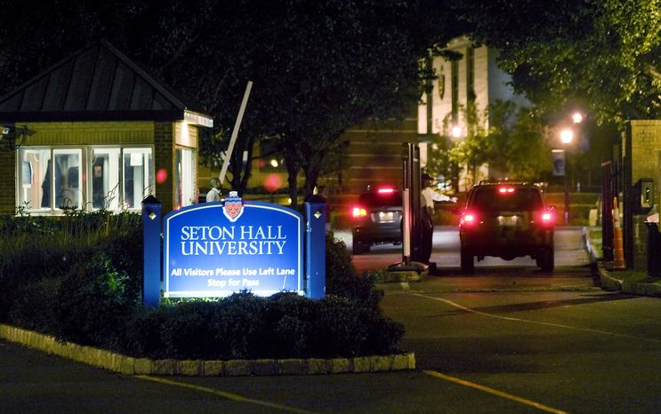 All vehicles entering the Seton Hall University campus on Saturday evening, Sept. 25, 2010, were stopped at the security gate after five students were shot, one of whom died, at an off-campus party early Saturday in East Orange, NJ. (AP Photo/Joe Epstein)