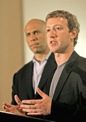 Mark Zuckerberg (right), Facebook founder, says he was inspired to give $100 million to the Newark, N.J., public schools system by the mayor. (Associated Press)