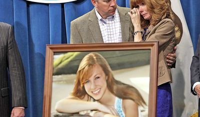 Kelly King, mother of murdered Chelsea King, in photo, attends an April news conference with husband Brent in Sacramento, Calif., to back Chelsea's Law, which jails some sex offenders for life after the first offense. (Associated Press)